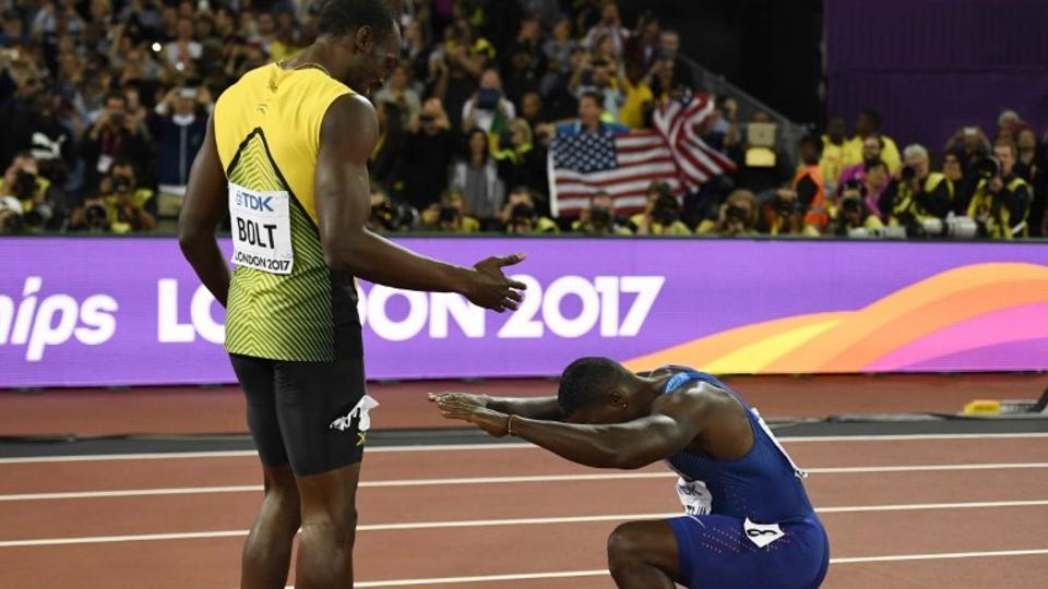 Usain Bolt and Justin Gatlin (right) after the men's 100m final at the IAAF World Championships of Athletics in London on Saturday.