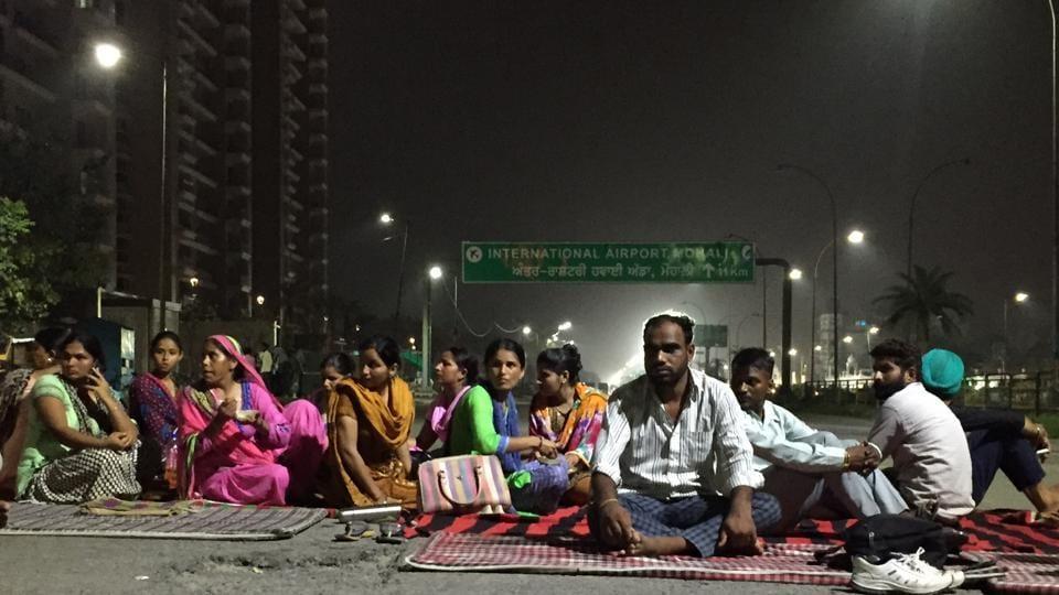 Protesters blocking the Airport Road near the Sohana gurdwara in Mohali on Sunday.