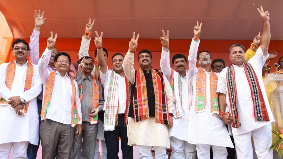 Union minister Dhramendra Pradhan with newly inducted axed Trinamool Congress MLAs in Tripura on Monday.