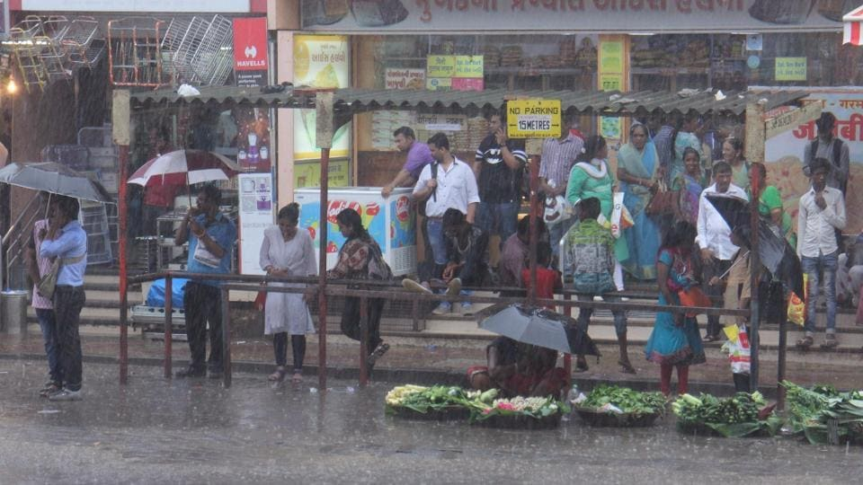 Commuters wait in vain at a bus stop in Borivli.
