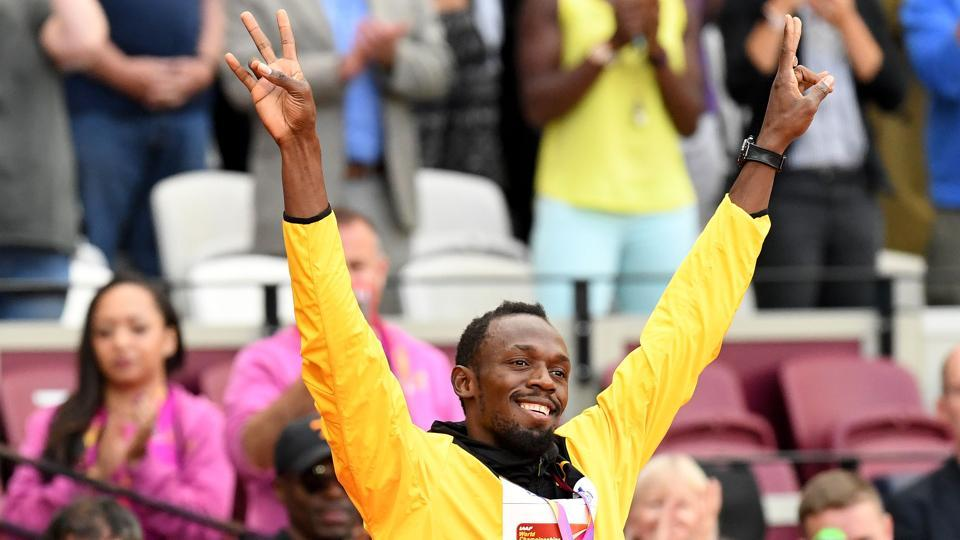 Usain Bolt acknowledges the cheer from the crowd after receiving his medal during the podium ceremony of the men's 100m event at the IAAF World Championships of Athletics in London on Sunday. (AFP)