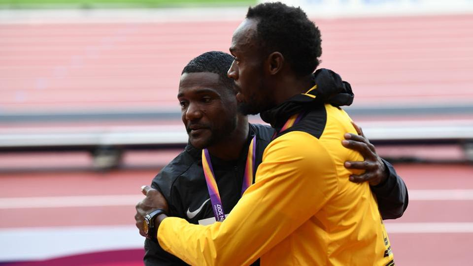 Justin Gatlin (L) and Usain Bolt have tremendous mutual respect for each other with the Jamaican naming the American as one of his toughest rivals. Gatlin, on his part, adores Bolt  and bowed down to him after finishing the race, winning the men's 100m event at the IAAF World Championships of Athletics in London on Saturday night. (AFP)
