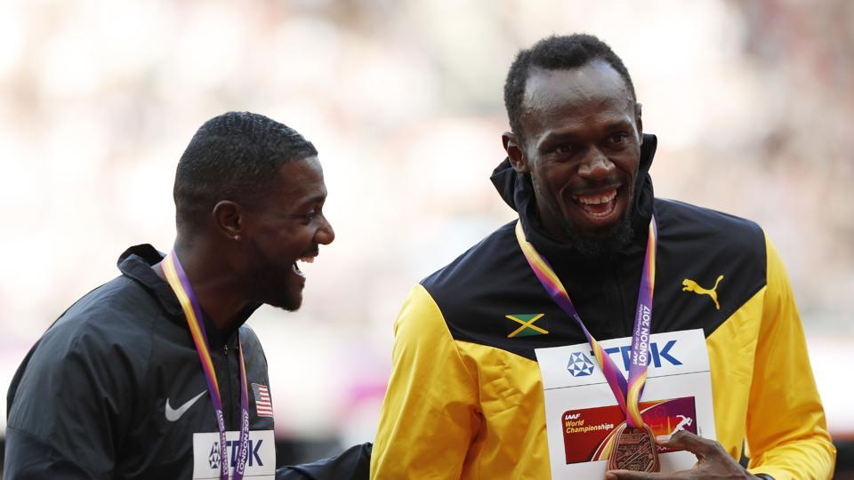 Gold medallist Justin Gatlin (L) and bronze medallist Usain Bolt share a light moment during the podium ceremony of the men's 100m event at the IAAF World Championships of Athletics in London on Sunday. (AFP)