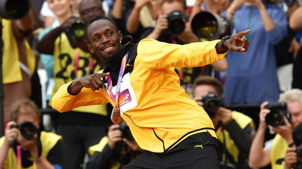 Usain Bolt demonstrates his trademark celebration for the fans one last time after the podium ceremony of the men's 100m event at the IAAF World Championships of Athletics. (AFP)
