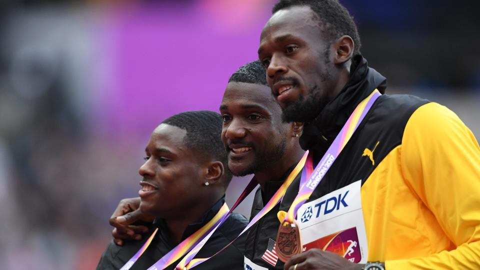 (L to R) Silver medallist Christian Coleman, gold medallist Justin Gatlin (C) and bronze medallist Usain Bolt (R) on the podium of the men's 100m event at the IAAF World Championships of Athletics in London on Sunday. (AFP)