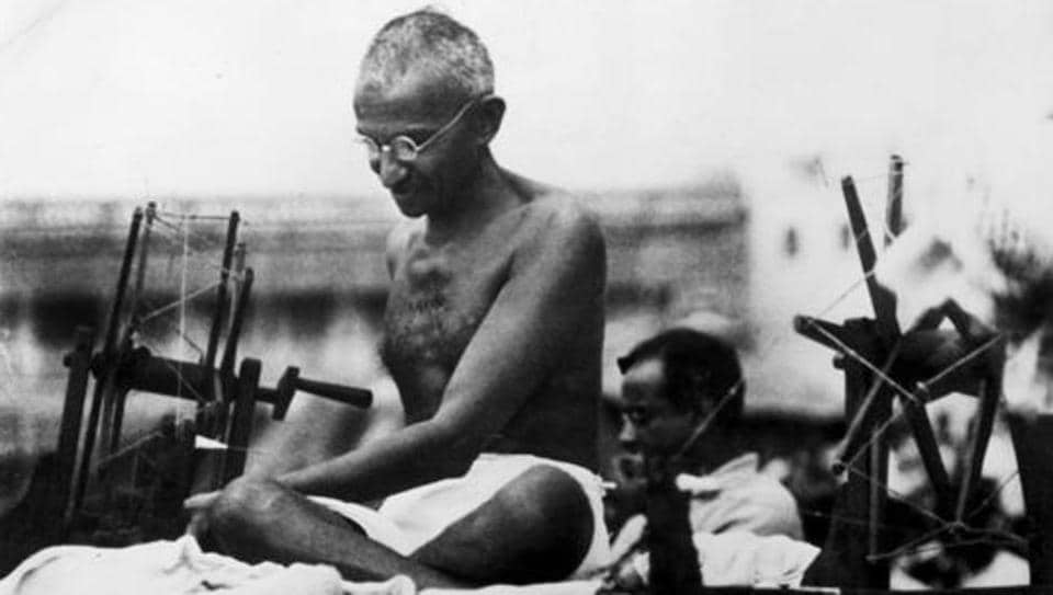 Mahatma Gandhi using a spinning wheel during a demonstration in Mirzapur, Uttar Pradesh on June 9, 1925.