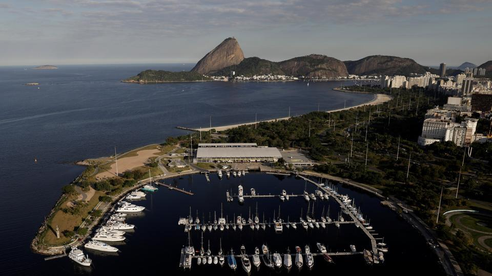 Rio organizers promised to clean up polluted Guanabara Bay in their winning bid in 2009. During the Olympics, officials used stopgap measures to keep floating sofas, logs, and dead animals from crashing into boats during the sailing events. The bankruptcy since the Olympics ceased major efforts to clean the bay.  (Ricardo Moraes/REUTERS)