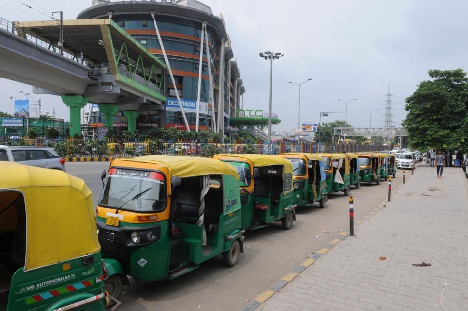 Auto-rickshaw stand at Huda City Centre junction in Gurgaon.