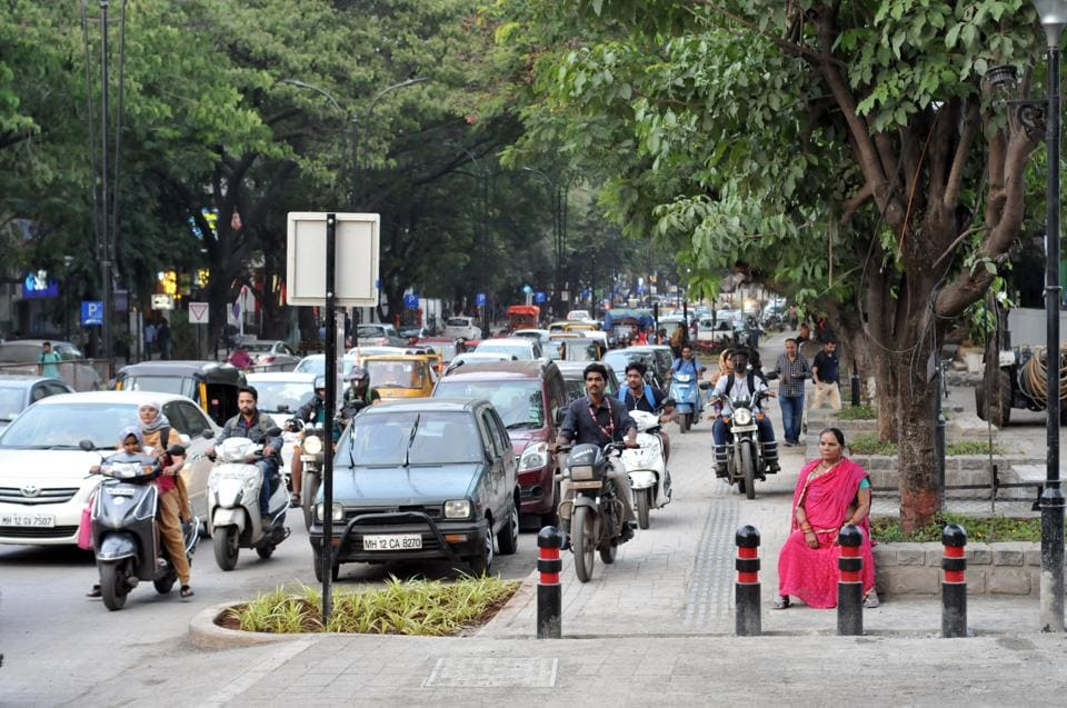 two wheeler riders have been blatantly mis-using the broadened footpath to bypass the slow-moving traffic during peak hours.