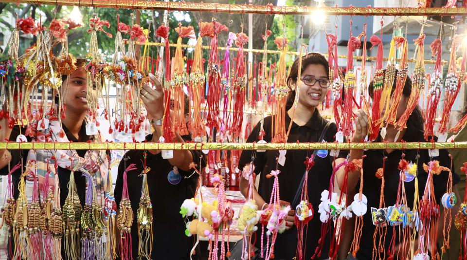Girls choose rakhis for their brothers at a stall in Pune. (Rahul Raut/HT PHOTO)