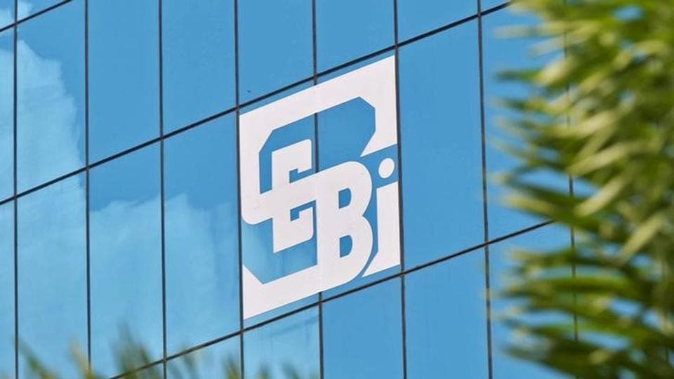 The logo of the Securities and Exchange Board of India (SEBI) is seen on the facade of its head office building in Mumbai,  July 13, 2015.