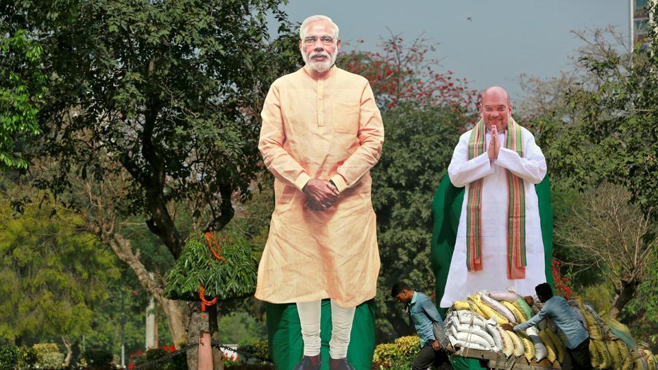 Giant cardboard cut outs of Prime Minister Narendra Modi and Bharatiya Janata Party president Amit Shah, New Delhi