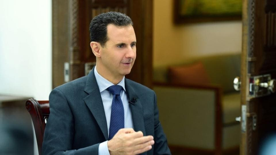 Syria's President Bashar al-Assad speaks during an interview with RIA Novosti and Sputnik in Syria.