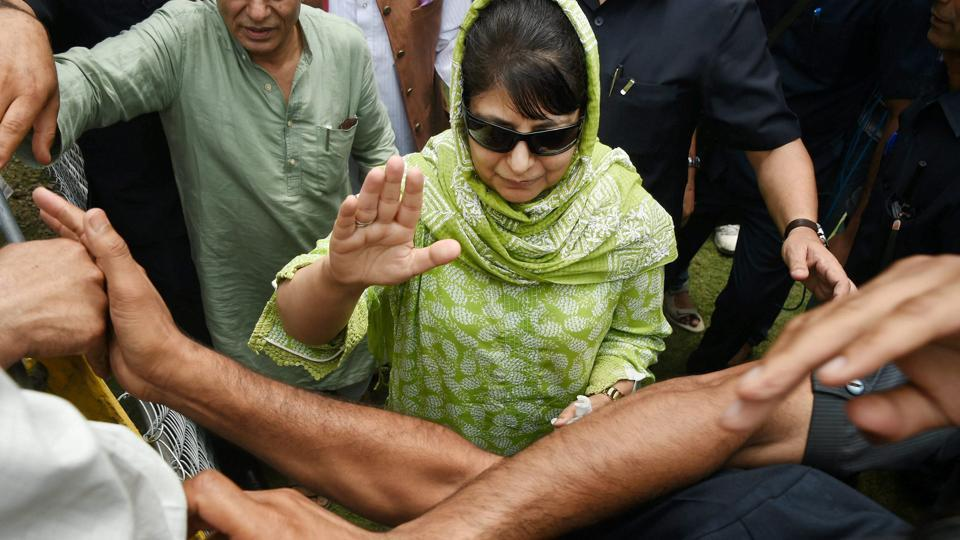 Jammu and Kashmir Chief Minister and PDP President Mehbooba Mufti waves to supporters during party's 18th foundation day in Srinagar on July 29, 2017.