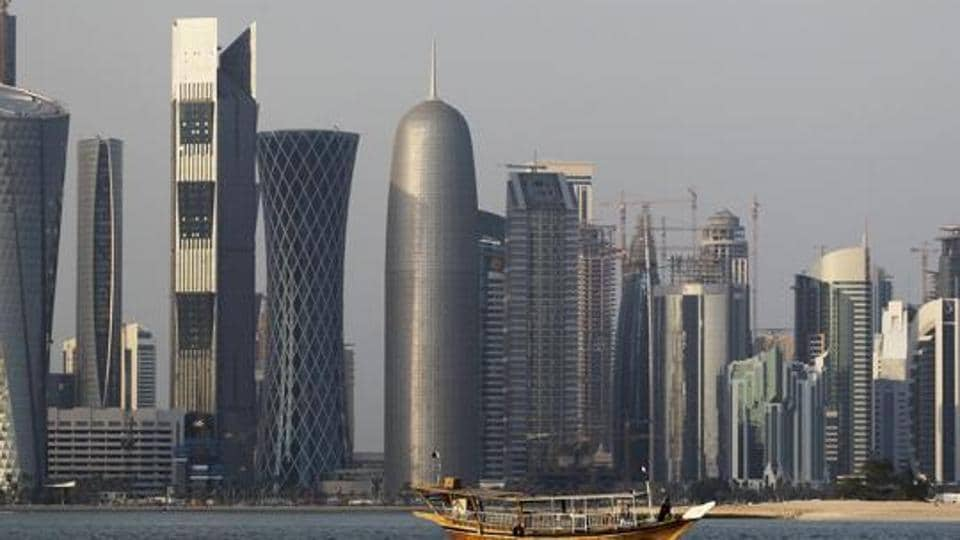 File photo of a traditional dhow floating in the Corniche Bay of Doha, Qatar, with tall buildings of the financial district in the background.