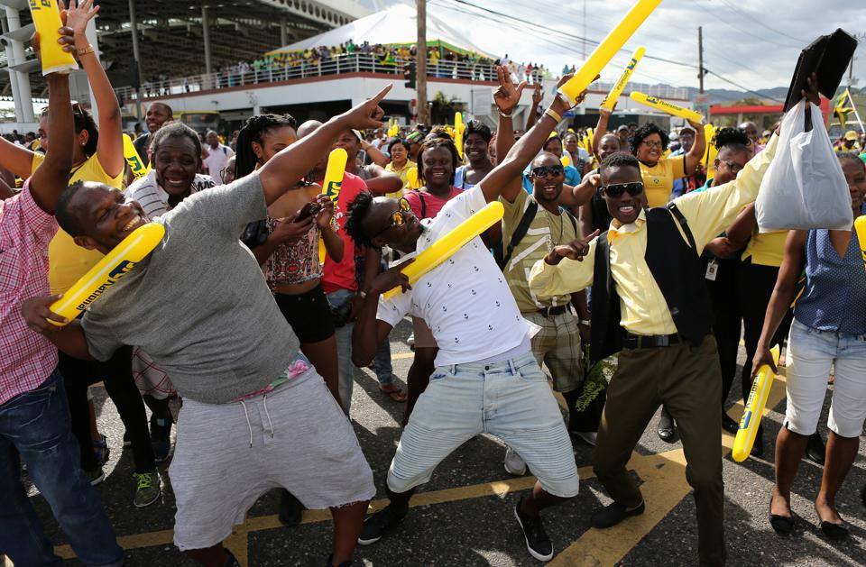 Usain Bolt's fans back home in Kingston, Jamaica, mimicked their champion's pose as they witnessed men's 100m final at the IAAF World Championships of Athletics in London. (REUTERS)
