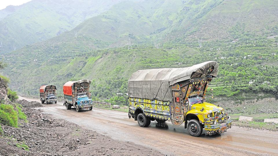 Trucks carrying goods travel through the Srinagar-Muzaffarabad road. Trade on this route is scheduled to resume on August 8. (HT file photo)