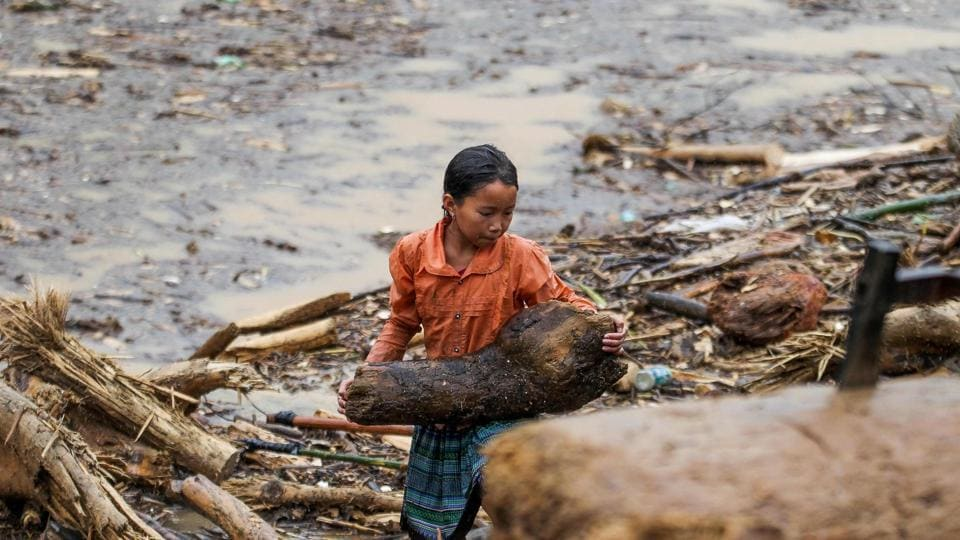 Flooding has crippled four Vietnamese provinces, damaging water systems and farms where rice and fruit are grown, with about 200 homes destroyed and 400 more affected. (AFP)