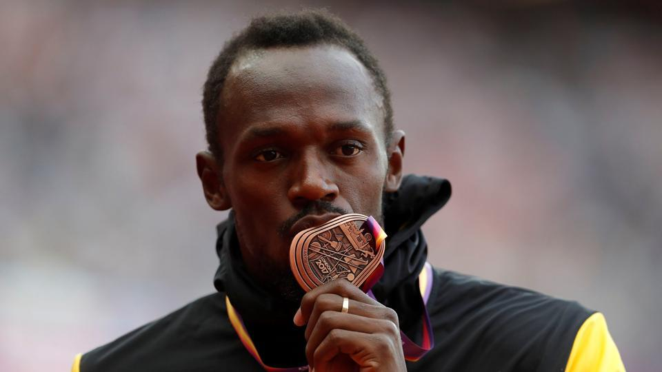 Usain Bolt of Jamaica with his bronze medal after the podium ceremony of the men's 100m event at the IAAF World Championships of Athletics in London on Sunday. The race, which was Bolt's final solo competitive event, was won by Justin Gatlin of the US, while the sliver medal went to American Christian Coleman (REUTERS)