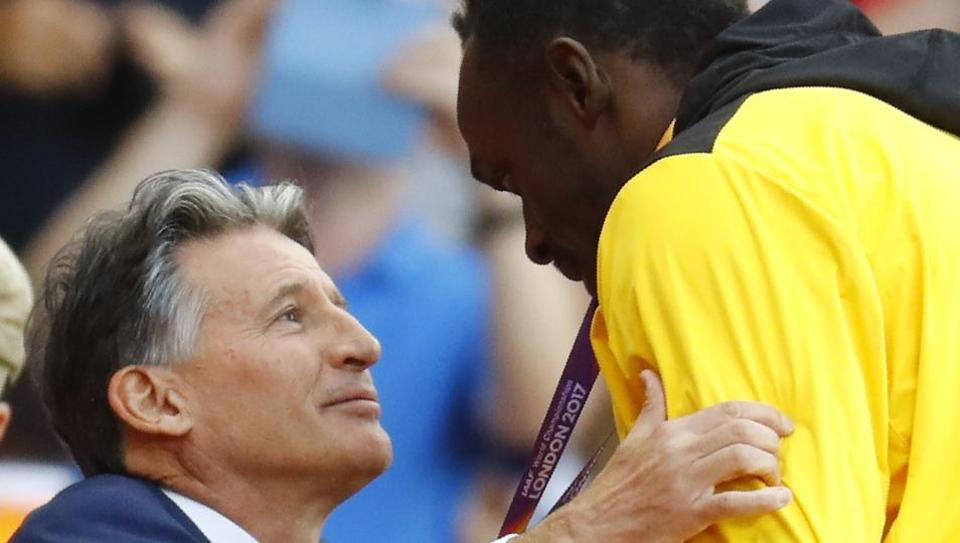 IAAF president Sebastian Coe presents Usain Bolt his bronze medal at the podium ceremony of the men's 100m event at the IAAF World Championships of Athletics in London on Sunday. (REUTERS)