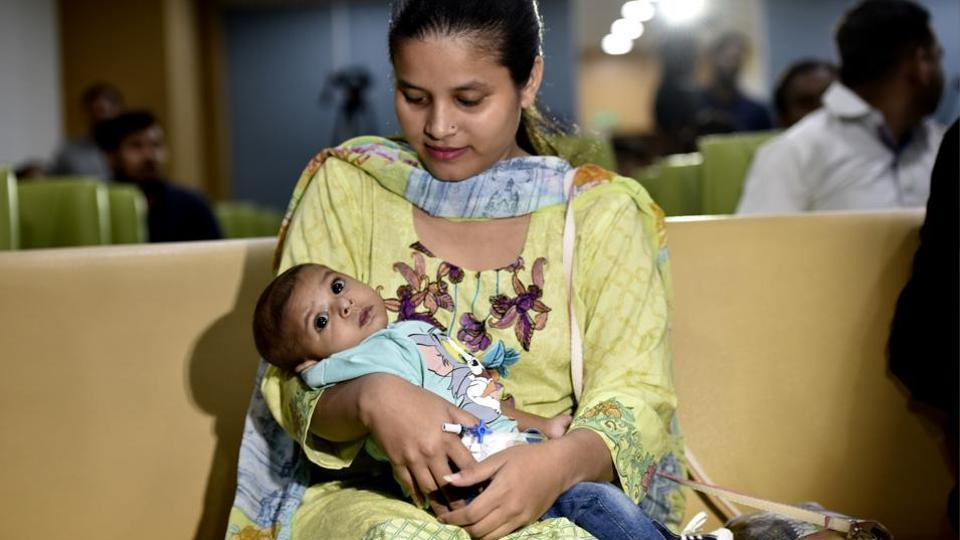 File photo of Rohaan, with his mother Anam Sadiq, after the surgery at Jaypee Hospital in Noida two months ago.