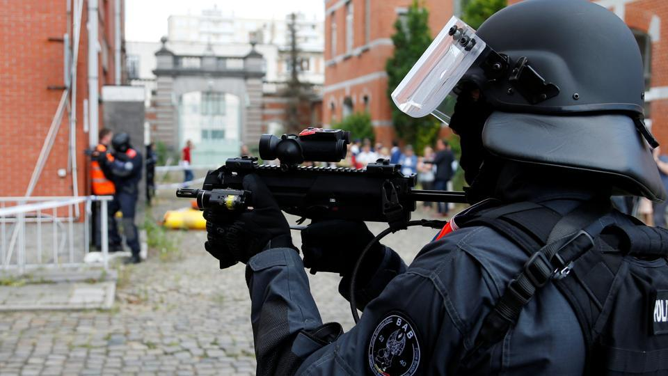 Members of Belgian police special units take part in a mock terrorist attack in a theatre in Brussels on July 4, 2017.