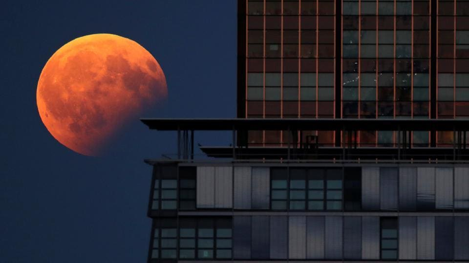 A partial lunar eclipse is pictured beside a building in Berlin, Germany. A penumbral lunar eclipse takes place when the moon moves through the faint, outer part of Earth's shadow.  (REUTERS)