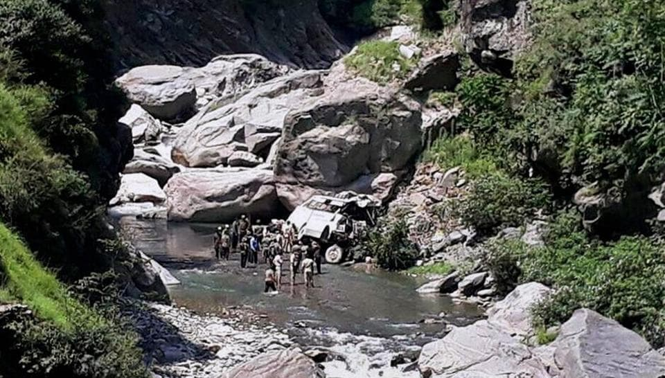 Rescue personnel carry out relief and rescue work after a bus fell into a gorge near the Jammu-Srinagar highway.