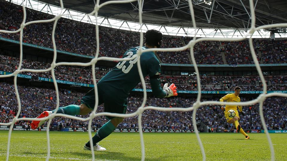 Chelsea's Thibaut Courtois (R) misses a penalty during the penalty shootout against Arsenal in last Sunday's Community Shield clash at Wembley.