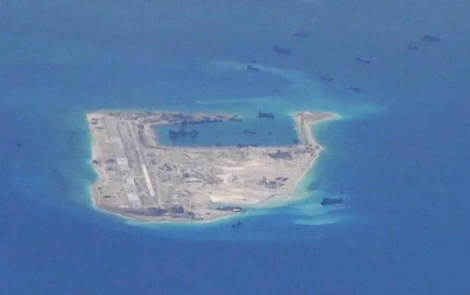 Chinese dredging vessels are purportedly seen in the waters around Fiery Cross Reef in the disputed Spratly Islands in the South China Sea.
