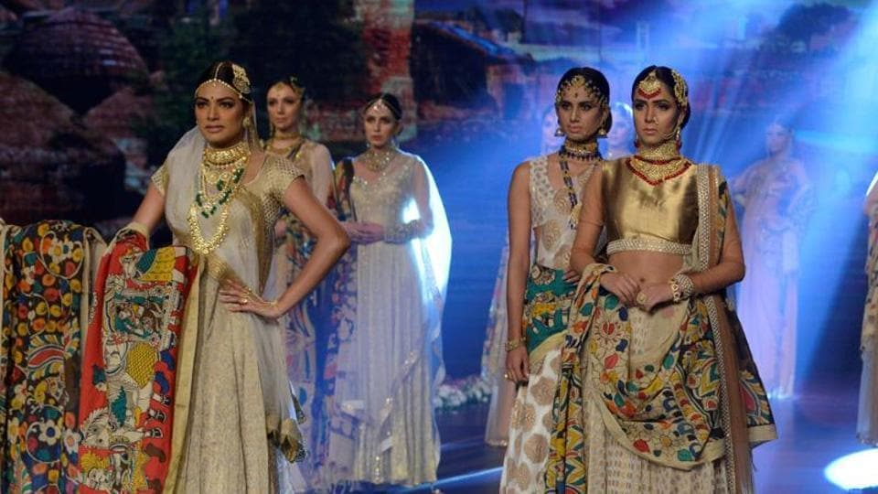 Pakistani models present creations by designer Isalan Iqbal on the second day of the Fashion Bridal Couture Week in Lahore on November 26, 2016. The petitioner said fashion and modelling events were against the norms and values of the Pakistani society.