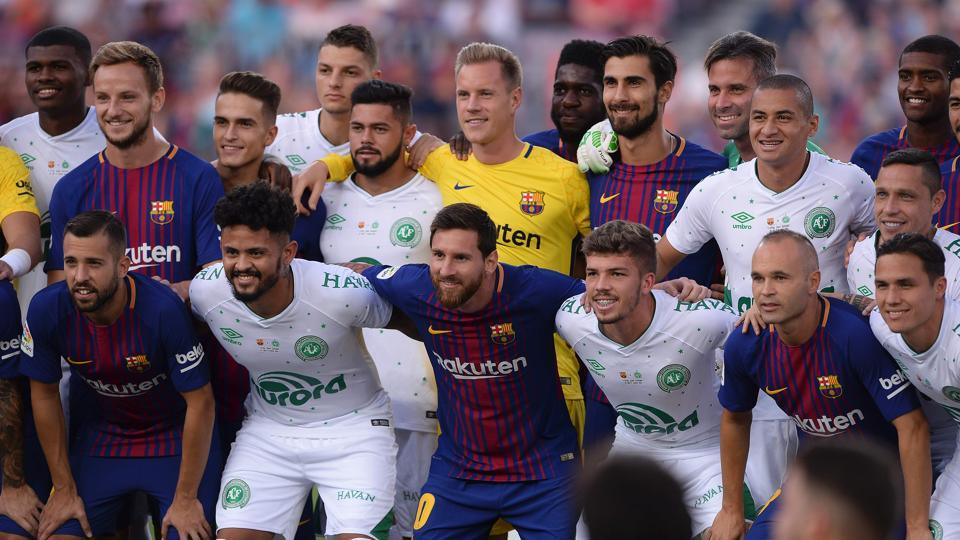 Barcelona and Chapecoense players pose before the 52nd Joan Gamper Trophy friendly football match between Barcelona FC and Chapecoense at the Camp Nou stadium in Barcelona on Monday.