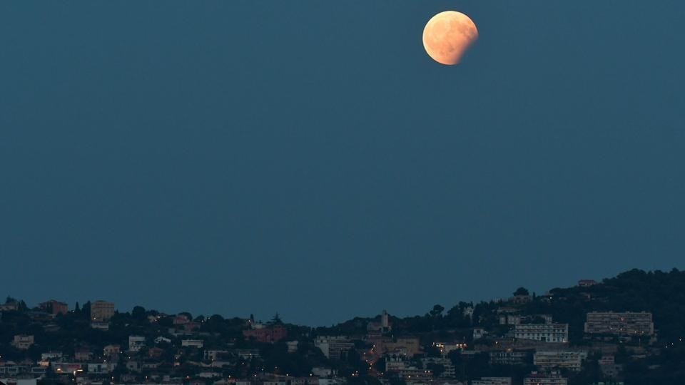 Partial lunar eclipse as seen in Nice southern France. The total duration of the penumbral eclipse was five hours and one minute and that of the partial eclipse one hour and 55 minutes.  (YANN COATSALIOUAFP)
