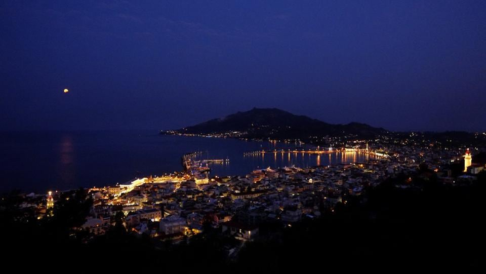 The August moon in seen in a partial lunar eclipse rise over the Ionian sea in Zakynthos island.  (Petros Karadjias/AP)