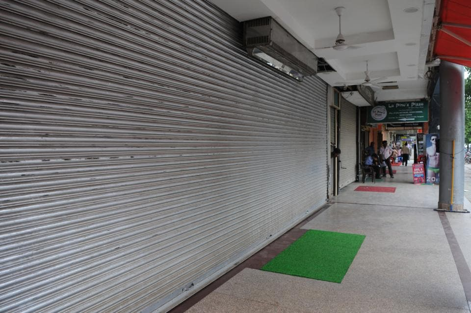 Shop owners closed their shops during protest against street vending policy of MCG at Sector 31.