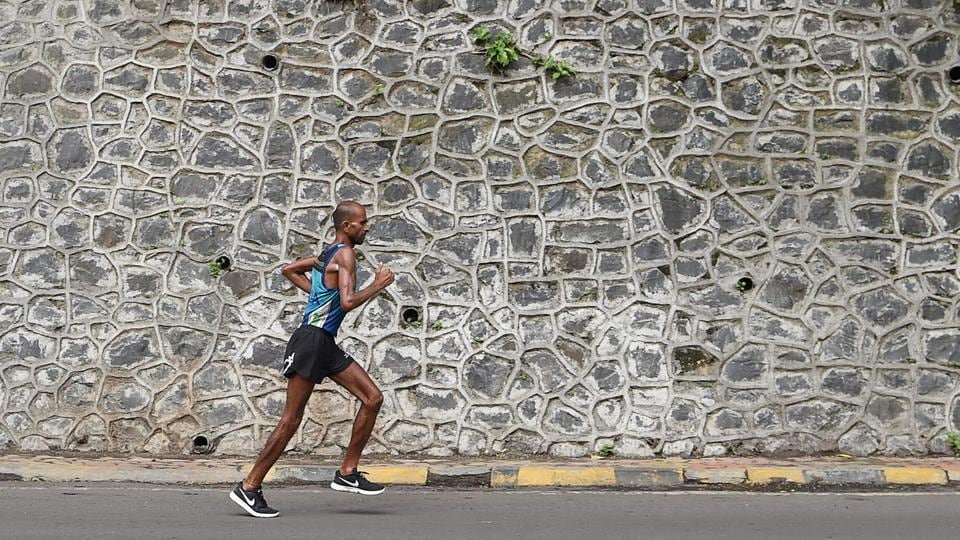 Indian ultra marathon runner Samir Singh undertook a herculean task of running 10,000km in a span of 100 days. Tormented by physical injuries, a lack of equipment and financial support, Singh managed to overcome restraints, finally succumbing to the pain and exhaustion his ambitious run wreaked on his body, ending just 36 kilometres short of his goal and covering 9,964kms in the nearly 3 month long run. (Indranil Mukherjee / AFP)