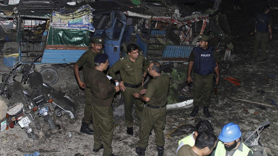 Pakistani security personnel visit the site of a blast in Lahore, Pakistan, Monday, Aug. 7, 2017.