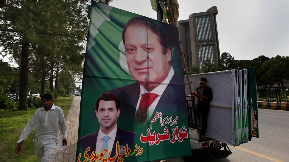 Pakistani workers install a huge billboard of deposed prime minister Nawaz Sharif on the planned route of his rally at a highway in Islamabad on August 8, 2017. According to Malik Mohammad Ahmed, an official spokesman in Punjab where Lahore is the provincial capital, Sharif plans to travel with a convoy of supporters by road from the federal capital of Islamabad to Lahore.