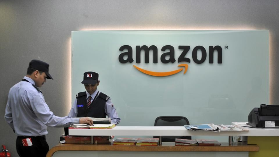 Security guards stand at the reception desk of the Amazon India office in Bengaluru, India, August 14, 2015.