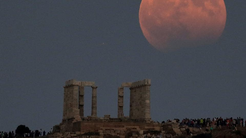Temple of Poseidon is seen as a full moon is partially covered by the Earth's shadow during a lunar eclipse in  east of Athens, Greece.  (Costas Baltas/REUTERS)