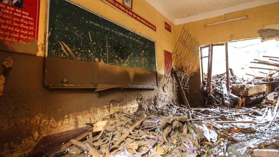 An elementary school classroom is filled with mud and debris after flash floods hit the mountainous town of Mu Cang Chai. (AFP)