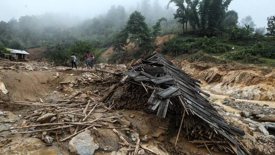 Thousands of people in the two most affected provinces of Son La and Yen Bai have been mobilized to rebuild houses, roads, and to search for those still missing. (AFP)