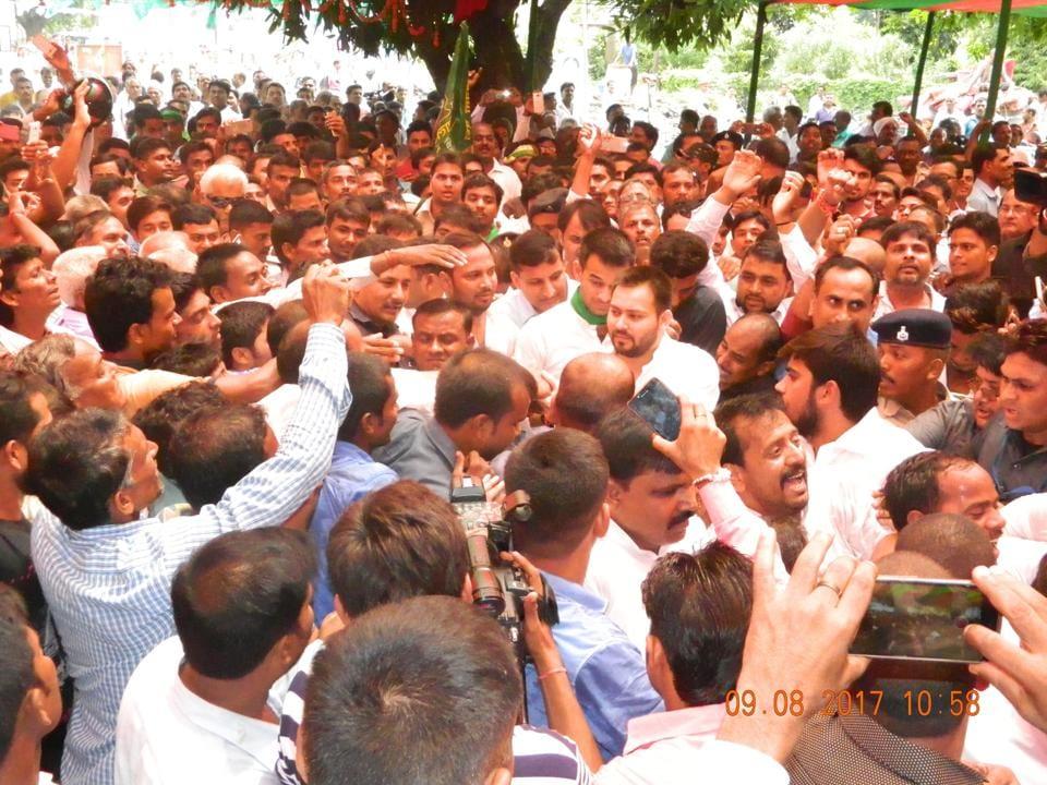 RJD leader Tejashwi Prasad Yadav (centre) with supporters at Gandhi memorial, Motihari,