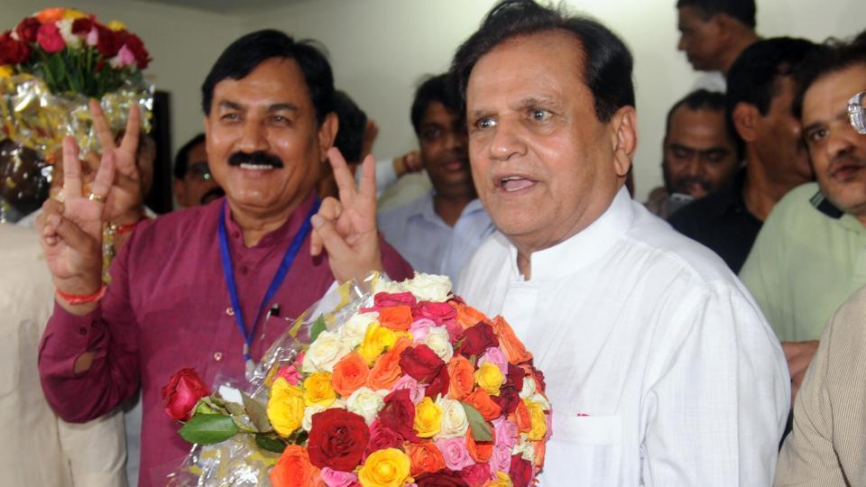 Ahmed Patel celebrates after winning the Rajya Sabha election.