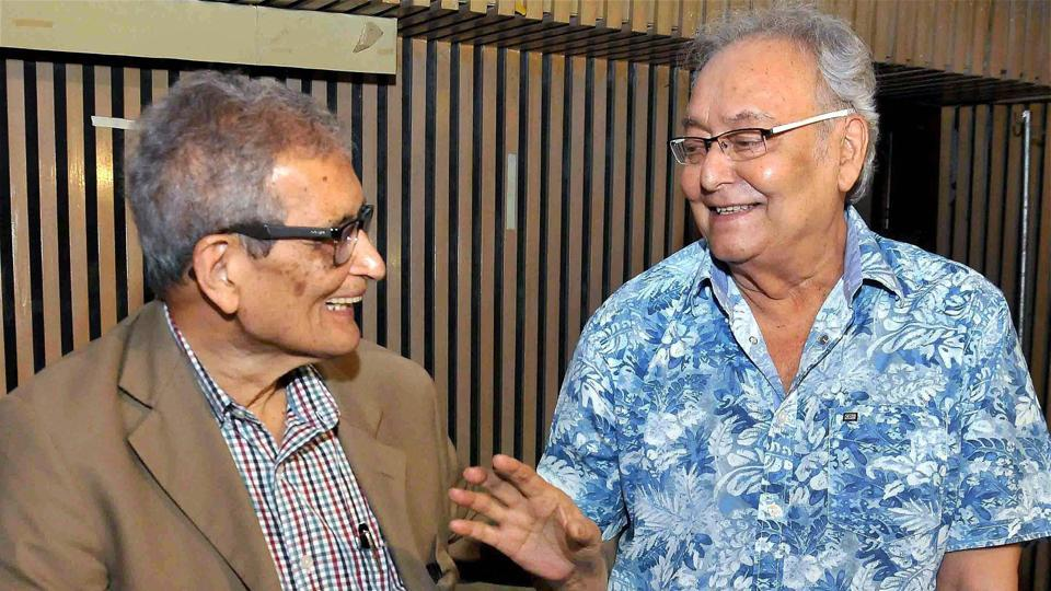 Nobel Laureate Amartya Sen sharing a lighter moment with Dadasaheb Phalke awardee and legendary actor Soumitra Chatterjee (R) during the special screening of Argumentative Indian documentary on Amartya Sen, in Kolkata.