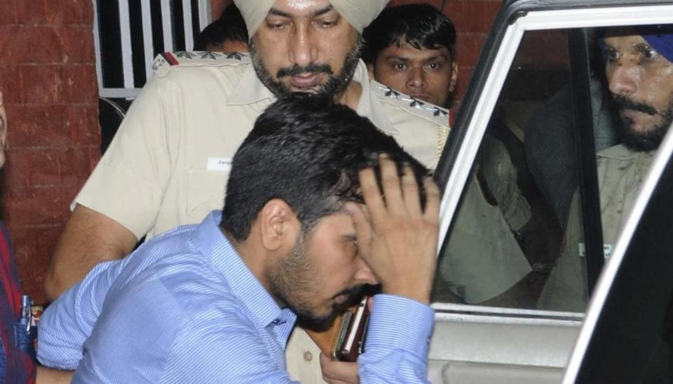 Vikas Barala in Chandigarh police custody at the Sector-26 police station on Wednesday, August 9.