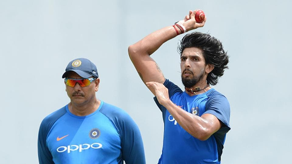 India cricket team pacer Ishant Sharma (R) bowls in the nets as coach Ravi Shastri looks on during a practice session at the Sinhalease Sports Club (SSC) Ground in Colombo on August 1, ahead of second Test vs Sri Lanka national cricket team.