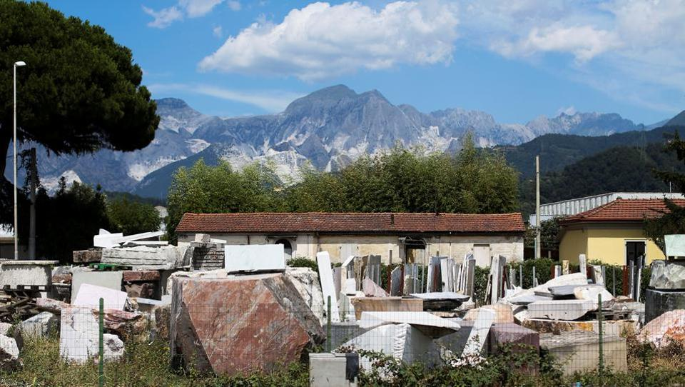 The Apuan Alps are seen in the background of a marble dealer's warehouse, littered with slabs, slivers and blocks of marble in Carrara, Italy. While Michelangelo himself was unable to make use of the marble of his dreams, its use by artists and in architectural landmarks over the centuries --facilitated by his efforts to pave the road to extraction--  would certainly sit well with the Renaissance master. (REUTERS)
