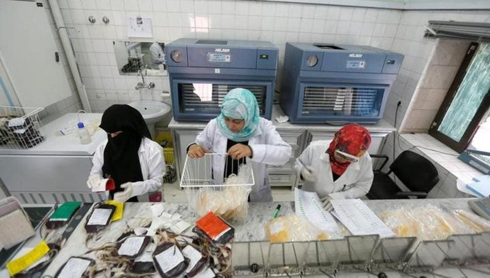 Employees register bags of blood at a blood transfusion centre in Sanaa, Yemen August 7, 2017.