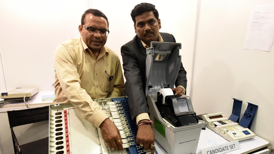 Election Commission of India officer conducting a live demonstration of the workings of the EVM and VVPAT machine at Vigyan Bhawan in New Delhi India on May 20, 2017,